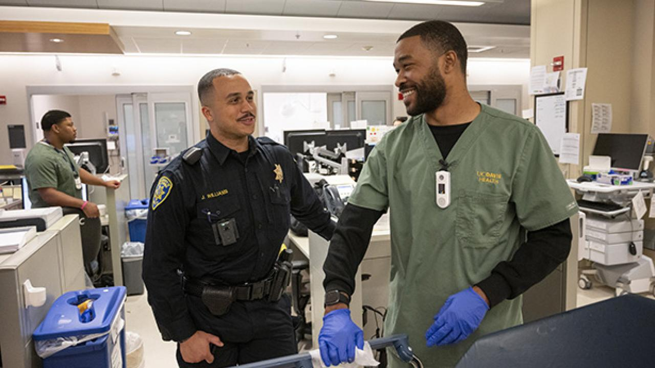 Officer greets a hospital worker